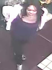 This woman was with a man suspected of pointing a gun