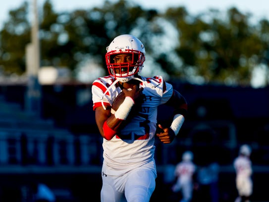 Austin-East's Jahson jackson (23) runs with the ball