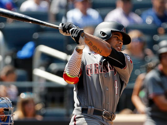 Arizona Diamondbacks Ketel Marte hits a sacrifice fly during the fifth inning of a baseball game against the New York Mets on Thursday, Aug. 24, 2017, in New York. (AP Photo/Adam Hunger)