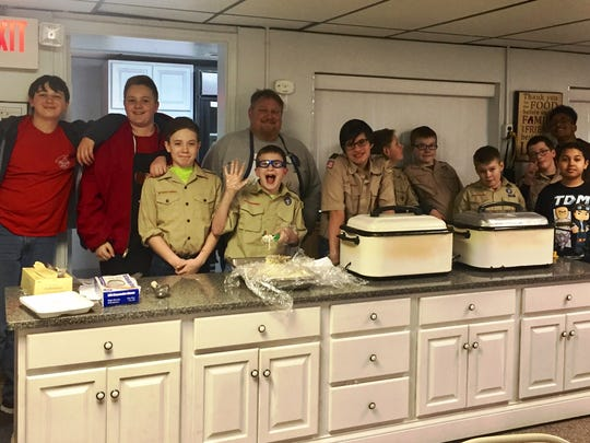A Kirkersville Boy Scout troop is holding a fish fry every Friday during Lent at Kirkersville United Methodist Church. Pictured from left to right are the scouts working on a recent Friday: Curtis Blasco, Jared Brandt, James Shull, Ethan Booher, Grant Blasco, John Strawn, Douglas Hamilton, Zane Ramsey, Joey Haley, Jase Orndorf , Lewis Keys and Chris Green.