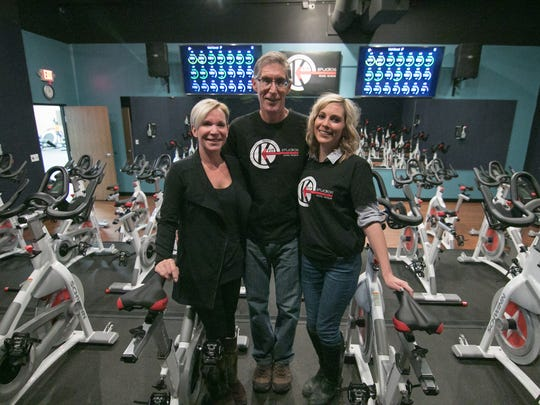 Shown from left Wednesday, Dec. 13, 2017, KFit Studios owners Kelly and Jeff Fletcher, and their daughter Jamie Fletcher show off the family's brick-and-mortar fitness studio, which they had to close during the pandemic.