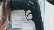Gun in an evidence bag.