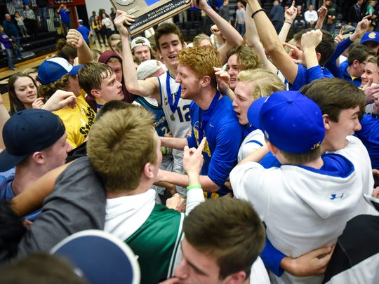 Cathedral players celebrate after their win against Melrose the Section 6-2A championship game Friday, March, 17,  at Halenbeck Hall in St. Cloud.