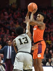 Clemson guard Shelton Mitchell (4) shoots over Wake Forest guard Bryant Crawford (13) during the 2nd half at Lawrence Joel Veterans Memorial Coliseum in Winston Salem, N.C. on Saturday, February 3, 2018.