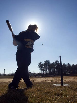 -  --  --  -Text: Limbering up for the upcoming Softball season, Lindenwold's Erasha Sawatsky a senior hit the ball into center field off a tee. Al Schell/Courier-Post