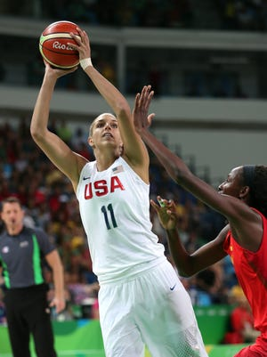 Elena Delle Donne shoots against Spain's Astou Ndour Gueye in the gold medal game Saturday.