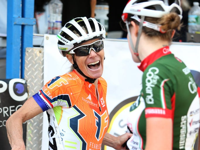 First place finisher Tina Pic (left) has a laugh with second place finisher Erica Allar after the main women's event of the Wilmington Grand Prix, Saturday, May 17, 2014.