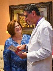 Brenda Reynolds with Dr. Emran Imani at Imani Skin & Cosmetic Center at TEPAS Healthcare in Melbourne.