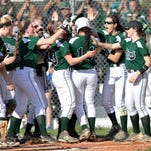 Floyd Central's Jenna Endris, 14, is congratulated by her teammates following her solo home run in the second inning of their game against Providence Friday, April 10, 2015.