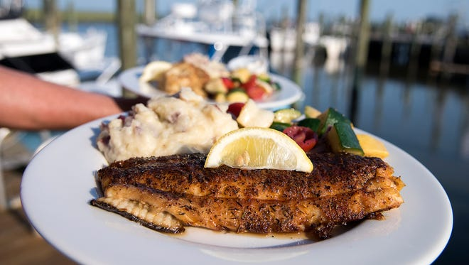 Locally caught flounder is served here with skin-on mashed potatoes and a medley of roasted vegetables.