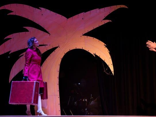 Haley Ondrejka who plays Lola walks across the stage