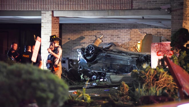 Police on the scene where a car crashed into a building on Paterson Avenue at Hackensack Street in East Rutherford on July 14, 2018.