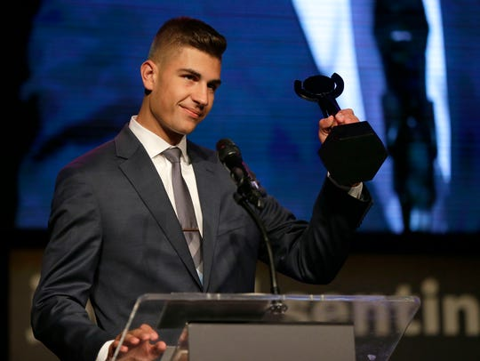 Boys athlete of the year, Max Alba, of Franklin High School, accepts his award at the Journal Sentinel High School Sports Awards on Monday night at the Pabst Theater.