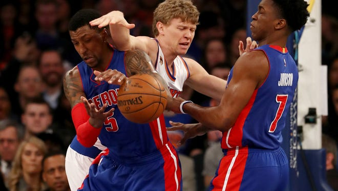 Knicks forward Mindaugas Kuzminskas loses the ball to the Pistons' Kentavious Caldwell-Pope, left, and Stanley Johnson in the first quarter of the Pistons' 109-95 loss Monday in New York.