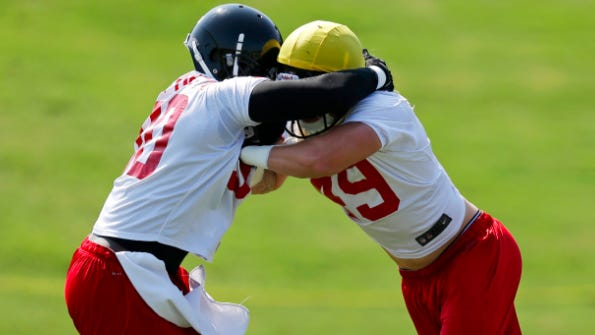 Atlanta Falcons' Stansly Maponga, left, works against teammate Tyler Starr during a drill on June 19/