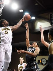 Colorado guard George King (24) goes up for a layup