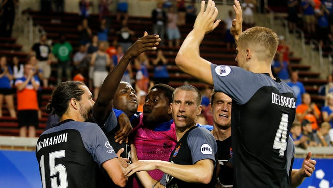 FC Cincinnati striker Djiby Fall (9), left, is congratulates by teammates after scoring the go-ahead goal in the second extra time period during the Lamar Hunt US Open Cup game between AFC Cleveland and FC Cincinnati, Wednesday, May 17, 2017.