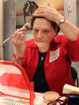 Kathy Jennings of the Bayville section of Berkeley applies makeup.