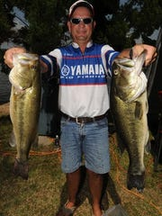 Local angler Jeff Holder holds up two of the fish that helped him and Trey Morgan win the 2001 All-City Championship.