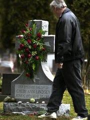 In this 2004 file photo, David Lindsey visited his daughter Cheri's grave at the Chenango Valley Cemetery in the Town of Fenton.