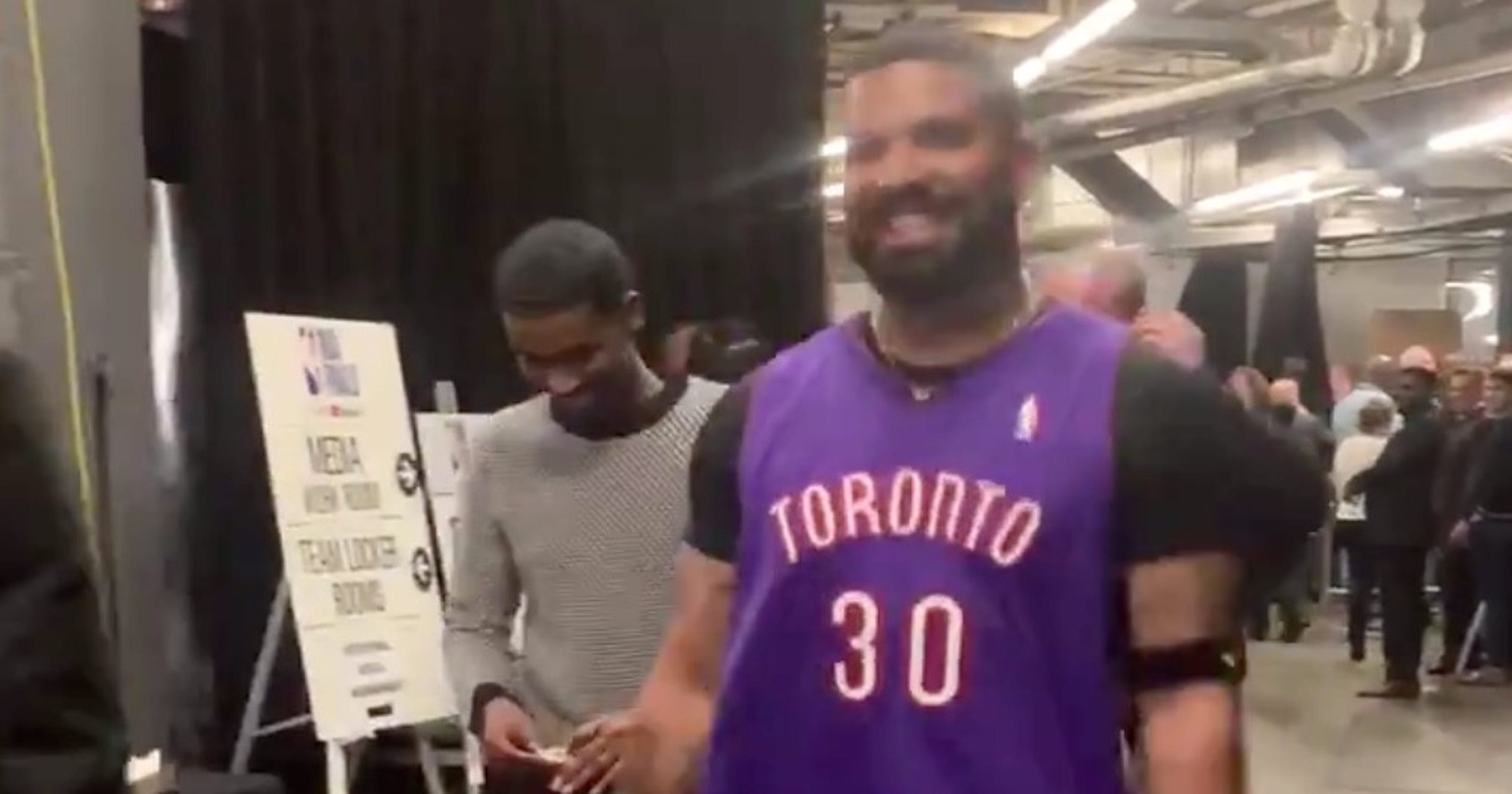 53161354c01 NBA Finals Game 1: Drake wears Dell Curry Raptors throwback jersey