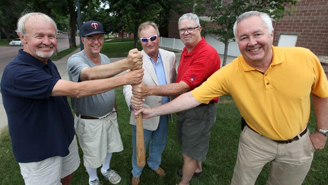 Terry Crandall (left to right), Dave Kemp, Brad Shaeffer, Pat Dunn and Andy Siverston stand where home plate used to be on the playground of All Saints School on Wed., July 1, 2015.