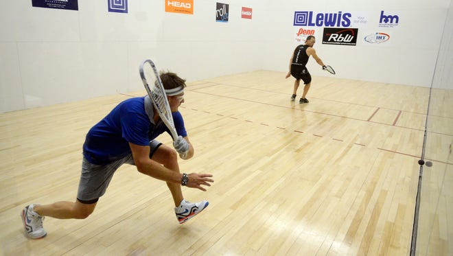 Kane Waselenchuk, left, takes on Rocky Carson in the men's singles pro championship at the Lewis Drug Pro-Am racquetball tournament in 2015. The tournament returns to the Downtown YMCA this year as Tier 1 event, the highest possible.