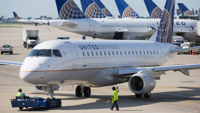A United Express Embraer E170 jet prepares for departure from Chicago O'Hare in June 2015.