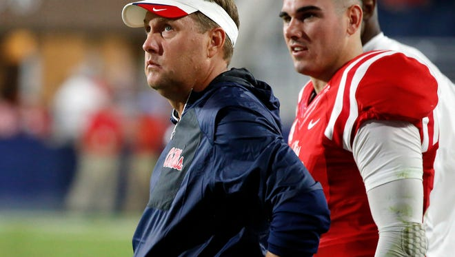 Hugh Freeze and Chad Kelly will try to lead Ole Miss to a bounce-back victory over LSU on Saturday.