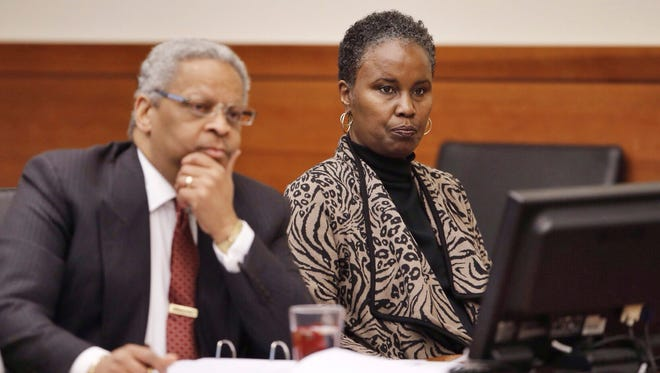 Sheila Kearns, right, listens to testimony in judge Schneider's Common Pleas Courtroom with attorney Geoffrey Oglesby on Tuesday, Jan. 13, 2015. The former substitute teacher who showed a movie featuring graphic sex and violence to a high school class has been convicted of disseminating matter harmful to juveniles. (AP Photo/The Columbus Dispatch, Chris Russell)