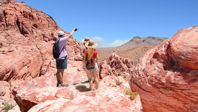 Hikers on public land take in one of Nevada's desert views.