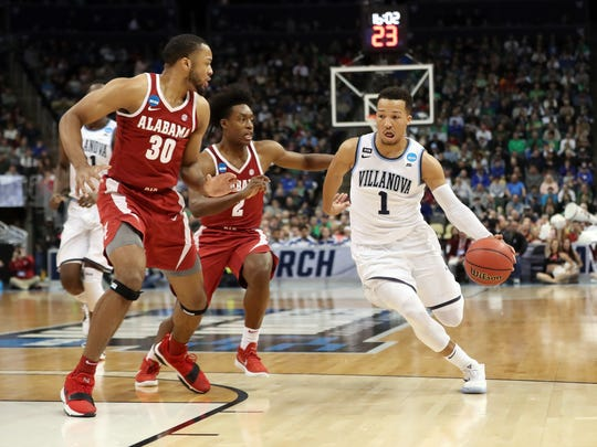 Villanova Wildcats guard Jalen Brunson (1) drives against Alabama Crimson Tide forward Galin Smith (30) in the second round of the 2018 NCAA Tournament.