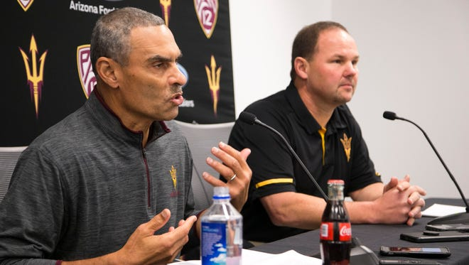 ASU head football coach Herm Edwards (left) talks about his first recruiting cycle while recruiting director Donnie Yantis looks on during a news conference at Sun Devil Stadium in on Wednesday, Dec. 20, 2017.