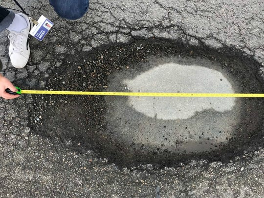 A 43-inch-long pothole on Ford Road in Canton, near North Sheldon Road.