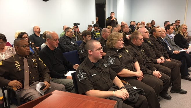 Delaware County sheriff's deputies and correctional officers pack a meeting of Delaware County Council on Tuesday.