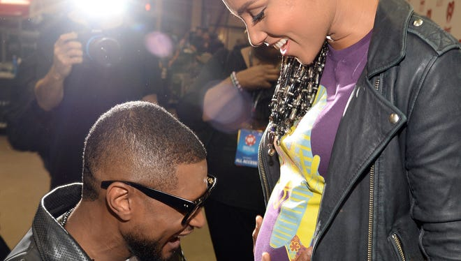 Usher (left) and Alicia Keys attend the iHeartRadio Music Festival at the MGM Grand Garden Arena on Sept. 19, 2014, in Las Vegas.
