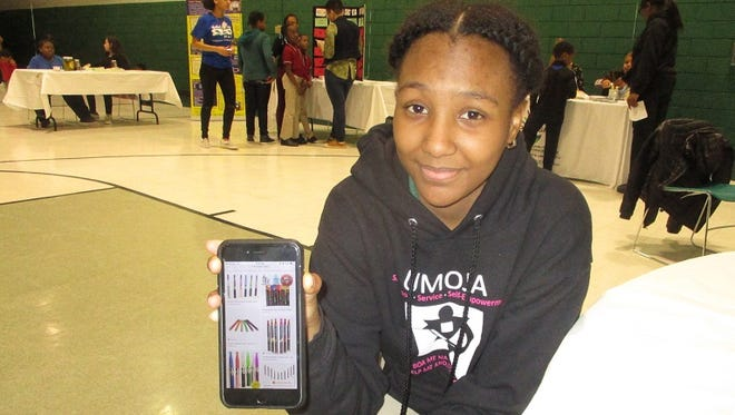At the Kick Butts Day anti-tobacco and drug rally held at Paterson's Christopher Hope Community Center, Leekia Gourzong, a 17-year-old John F. Kennedy High School junior, shows an image of portable hookah sticks she said are now being used by students.