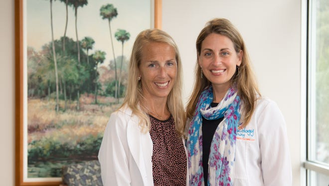 Stacey Marando (left), social worker, and Mary Smith, oncology nurse and breast health navigator, co-facilitate the Hand-in-Hand support group for women age 45 or younger who have been diagnosed with breast cancer.