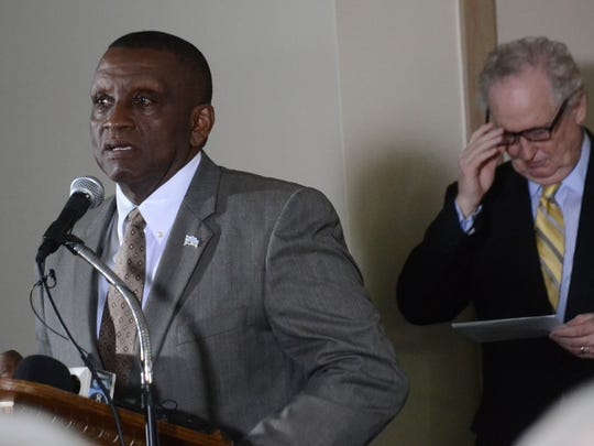 Pineville Mayor Clarence Fields (left) speaks at a press conference Wednesday about an aluminum manufacturing complex led by American Specialty Alloys that will create about 1,400 jobs.