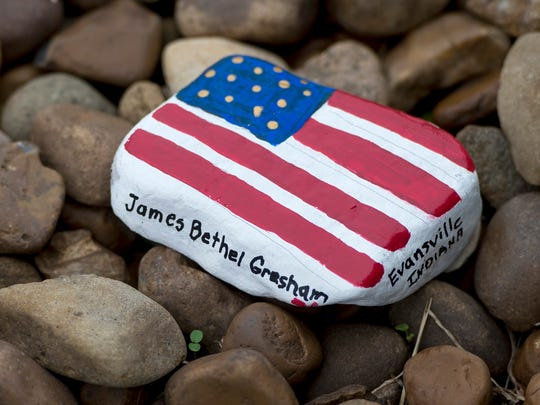 A stone painted with the American flag and the name James Bethel Gresham is seen during the James Bethel Gresham Commemoration at Locust Hill Cemetery in Evansville, Ind., on Friday, Nov. 3, 2017. Gresham was among the first American soldiers to reach the battlefield in France, and one of the first who passed in World War I.
