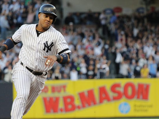 Starlin Castro rounds third on his way to scoring the Yankees first run in the second inning of Game 5, Wednesday, October 18, 2017.
