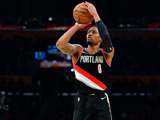 Damian Lillard shoots against the Los Angeles Lakers