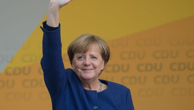 German Chancellor Angela Merkel addresses an election campaign rally of the Christian Democratic Union in Fritzlar, western Germany on Sept. 21, 2017.