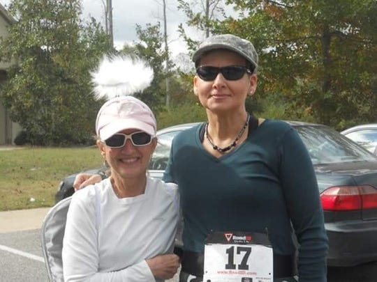 Peggy Lanier, left and Nancy Beale, at the Monster Dash 5K in 2012 in Auburn.