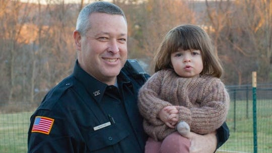 Officer Kevin Martyn visits Willa Splurgin days after he came into her home to perform life-saving CPR on the 2-year-old.