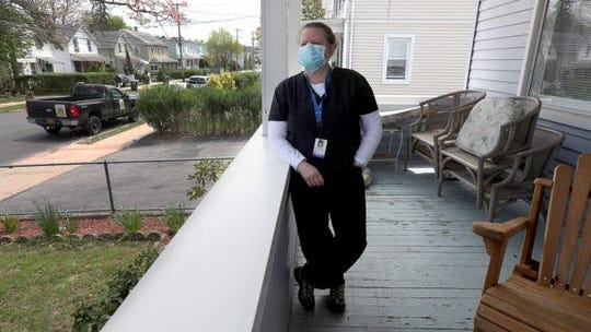 Joann Warner, a registered nurse with Visiting Nurse Services of Westchester, Inc., goes into coronavirus patients' homes on a daily basis as part of a job. Warner, photographed in Port Chester May 5, 2020, says that she sees COVID-19 patients towards the end of her day, after she has seen non-COVID patients so as not to potentially infect those that don't have the virus. Before entering the home of someone with COVID-19, she dons a full set of PPE, including a gown, face shield, and hair covering.