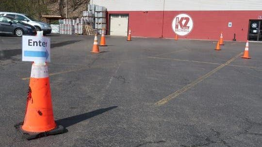The parking lot at K2 Brothers Brewing in Penfield has been turned into a drive-thru for beer pickup.