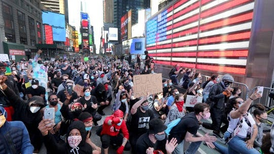 Several thousand protestors marched through midtown Manhattan May 31, 2020 to to protest the death of George Floyd in Minneapolis. The march paused in Times Square as organizers spoke to those gathered.