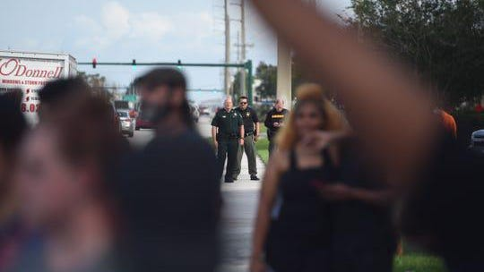JENSEN BEACH -- Protestors and police gather near the Treasure Coast Mall on Monday to bring attention to the death of George Floyd.