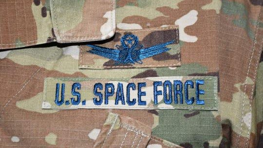 U.S. Air Force personnel who transfer into the U.S. Space Force would continue to wear the Operational Camouflage Pattern uniform currently worn by the Air Force and Army, but with distinct blue thread. They also would have a colored U.S. flag on the left arm.